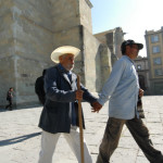Blind_man_with_an_assisting_man